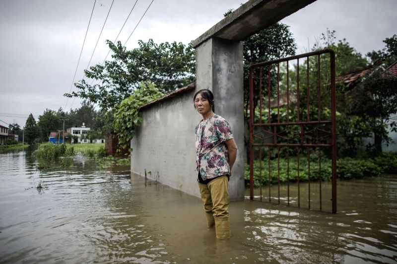 SHAYANG, July 21, 2016 - A villager stands in water in flooded Zhangji Village of Maliang Town, Shayang County, central China's Hubei Province, July 20, 2016. Heavy rain since Tuesday has affected ...