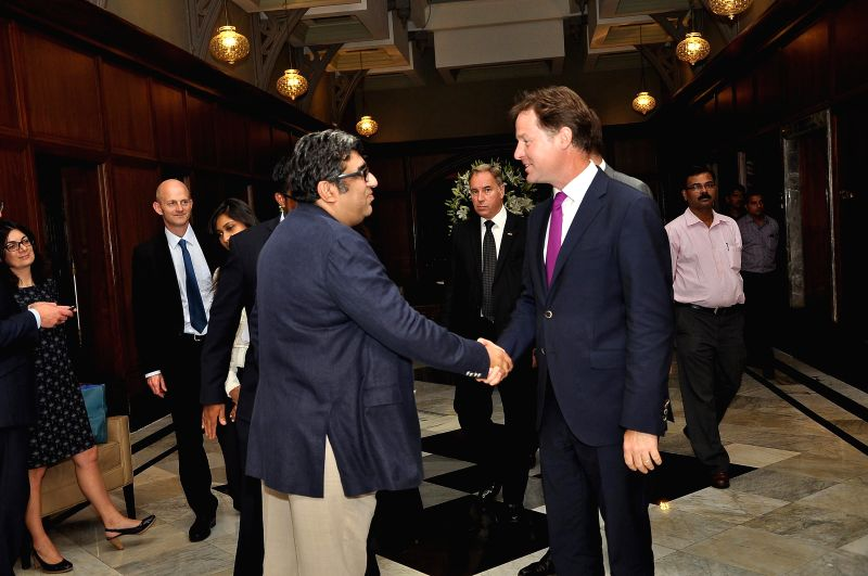 Sheetal Talwar with Deputy Prime Minister of U.K. Nick Clegg during the muhurat of Vistaar Film Fund`s and WSG Picture latest film Veda, in Mumbai, on Aug. 26, 2014.