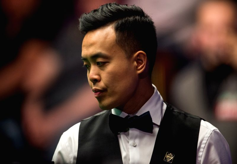 SHEFFIELD, April 17, 2017 - Marco Fu of Hong Kong of China competes during his first round match against Luca Brecel of Belgium during the World Snooker Championship 2017 at the Crucible Theatre in ...