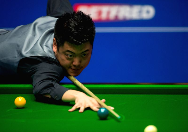 SHEFFIELD, April 19, 2017 - Liang Wenbo of China competes during his first round match against Stuart Carrington of England during the World Snooker Championship 2017 at the Crucible Theatre in ...