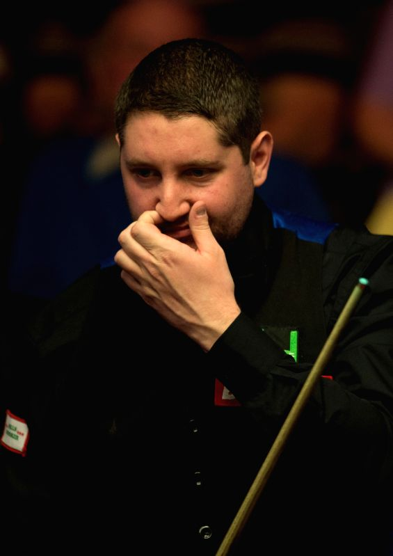 SHEFFIELD, April 19, 2017 - Stuart Carrington of England reacts during his first round match against Liang Wenbo of China during the World Snooker Championship 2017 at the Crucible Theatre in ...