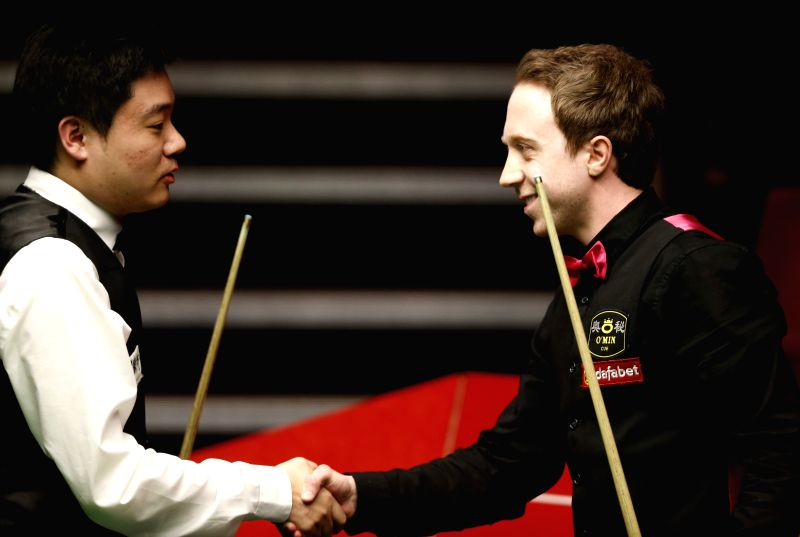 English Michael Wasley(R) shakes hands with Ding Junhui of China after their Round 1 match on Day 3 of World Snooker Championship at the Crucible Theatre in ...