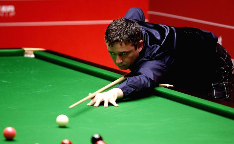 Scottish Alan McManus competes during his Round 1 match against his compatriot John Higgins on Day 3 of World Snooker Championship at the Crucible Theatre in ...