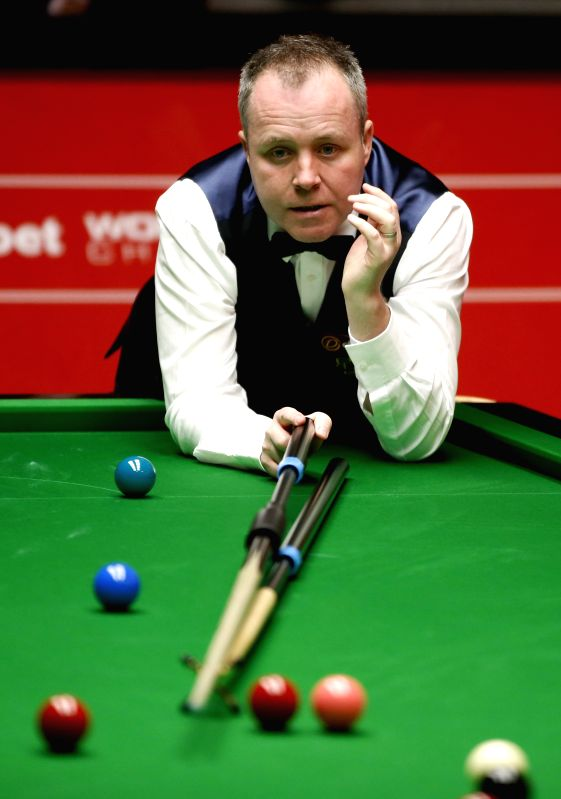 Scottish John Higgins competes during his Round 1 match against his compatriot Alan McManus on Day 3 of World Snooker Championship at the Crucible Theatre in ...