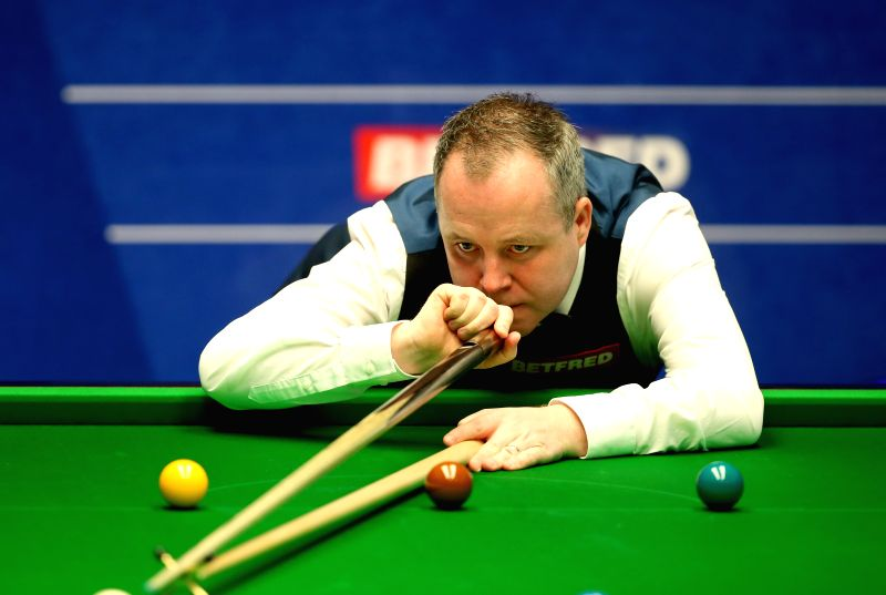 Scotland's John Higgins competes during the third session of the second round match against China's Ding Junhui at the 2015 World Snooker Championship at the ...
