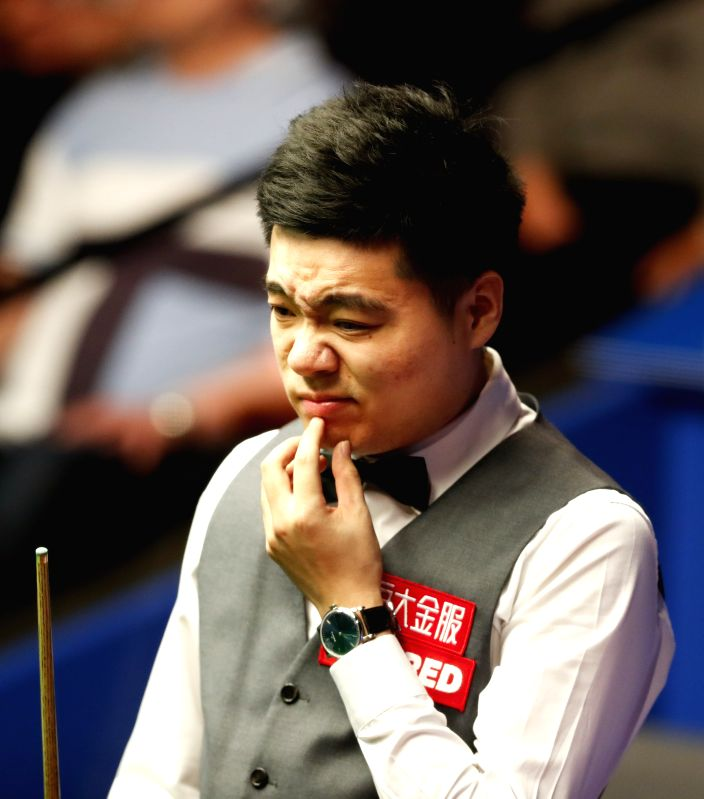 SHEFFIELD, April 26, 2017 - China's Ding Junhui reacts during the second session of his quarterfinal with England's Ronnie O'Sullivan at the World Snooker Championships 2017 at the Crucible Theatre ...