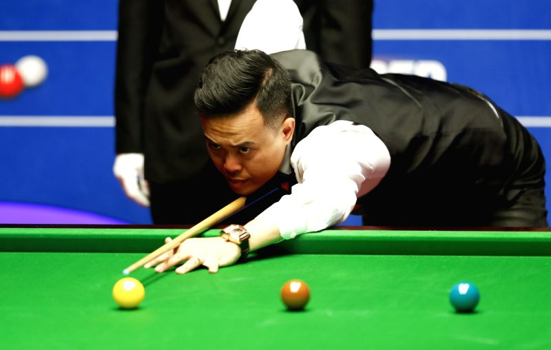 SHEFFIELD, April 26, 2017 - Marco Fu of China's Hong Kong competes during the second session of quarterfinal match against Mark Selby of England at the World Snooker Championships 2017 at the ...