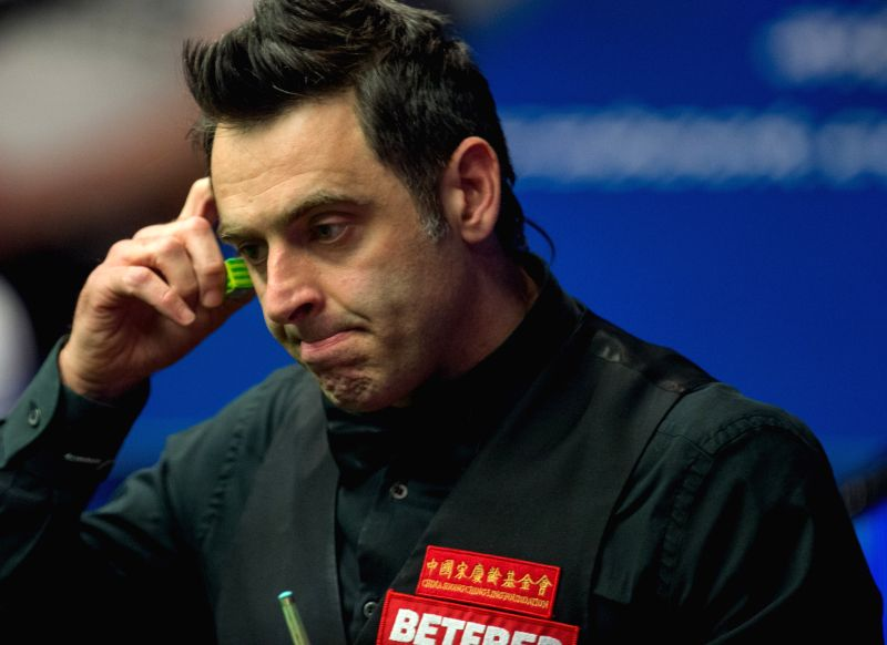 SHEFFIELD, April 27, 2017 - Ronnie O'Sullivan of England looks dejected as he competes against Ding Junhui of China during their quarterfinal match of World Snooker Championship 2017 at the Crucible ...
