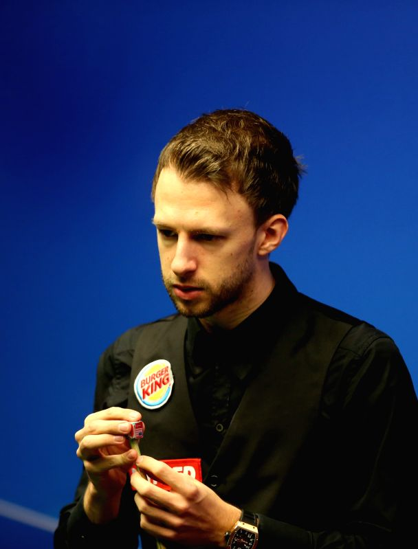 Judd Trump of England competes during the third session of the quarterfinal against Ding Junhui of China at the 2015 World Snooker Championship at the Crucible ...