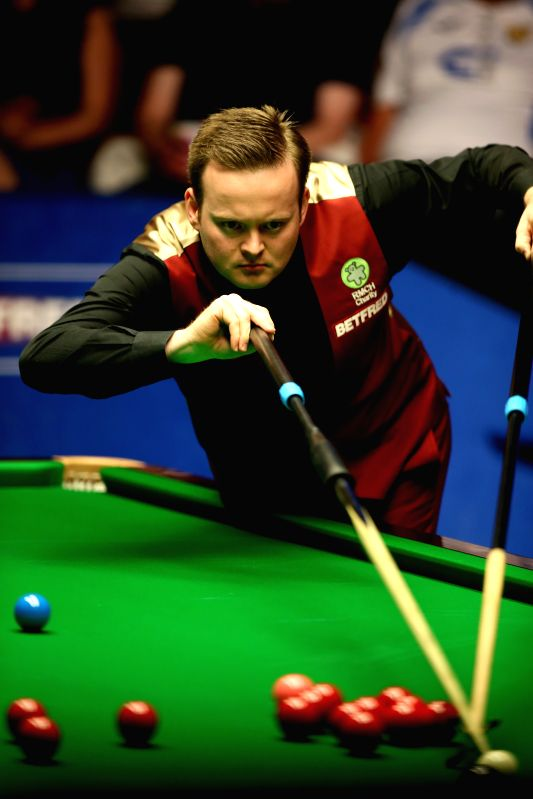 Shaun Murphy of England competes during the third session of the final with Stuart Bingham at the 2015 World Snooker Championship at the Crucible Theatre in ...