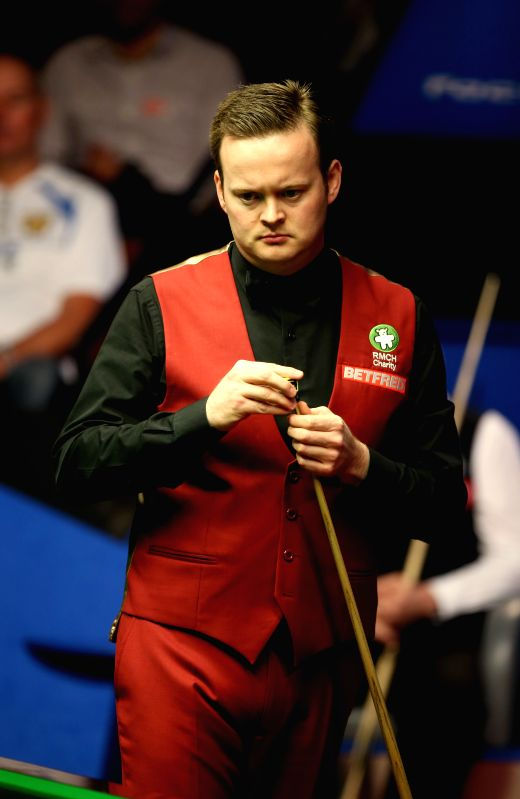 Shaun Murphy of England reacts during the third session of the final with Stuart Bingham at the 2015 World Snooker Championship at the Crucible Theatre in ...
