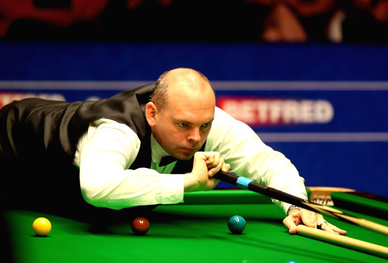 Stuart Bingham of England competes during the third session of the final with Shaun Murphy at the 2015 World Snooker Championship at the Crucible Theatre in ...