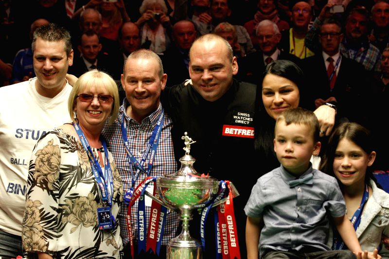 Stuart Bingham (C) of England celebrates with his family members during the awarding ceremony of the 2015 World Snooker Championship in the Crucible Theatre in ...