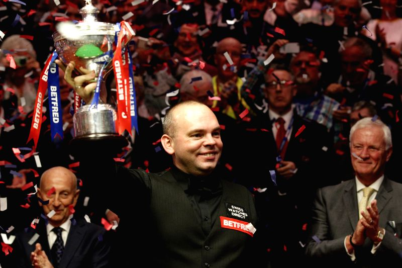 Stuart Bingham of England celebrates after the final with his compatriot Shaun Murphy at the 2015 World Snooker Championship in the Crucible Theatre in Sheffield, ...