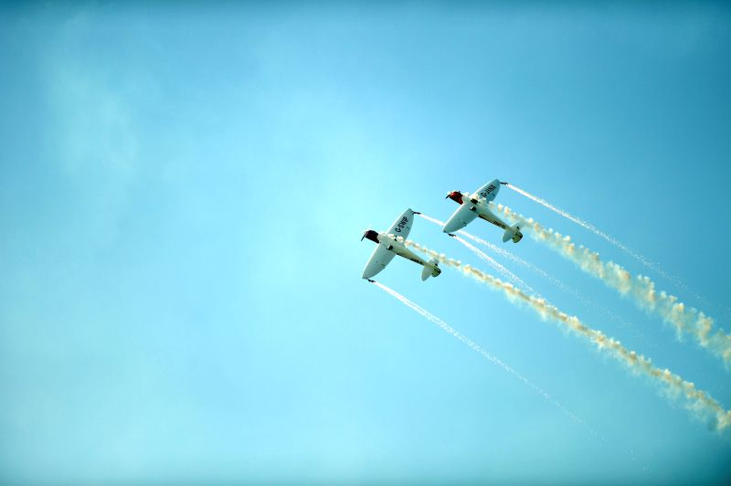 Two British pilots stage an stunt performance at the opening of the 2014 Shenyang Faku International Flight Convention, in Faku County of Shenyang, capital of ...