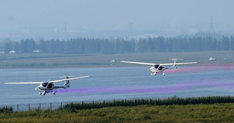 Two Chinese RX1E electronic planes are seen at the opening of the 2014 Shenyang Faku International Flight Convention, in Faku County of Shenyang, capital of ...