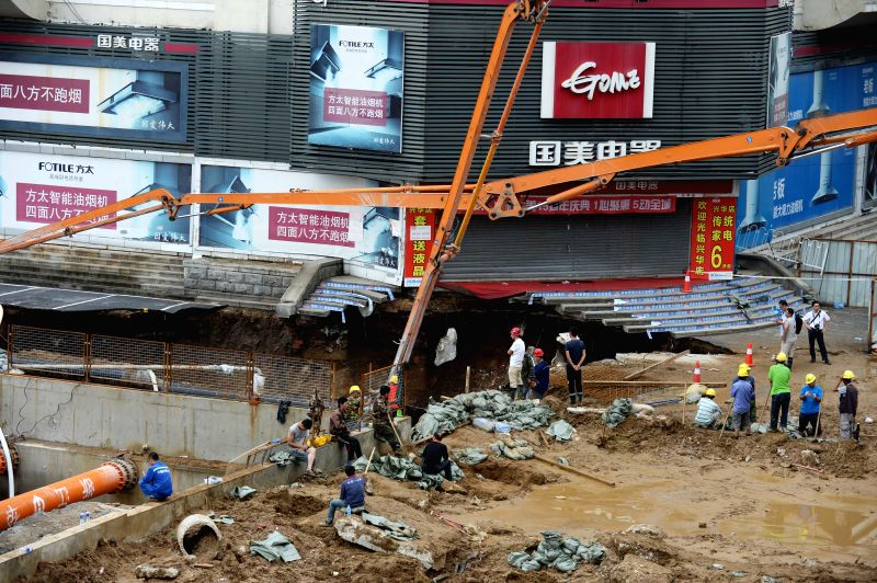 SHENYANG, July 26, 2016 - Rescuers work at the collapse site of the subway Line 9 that is under construction in Shenyang, capital of northeast China's Liaoning Province, July 26, 2016. Due to the ...