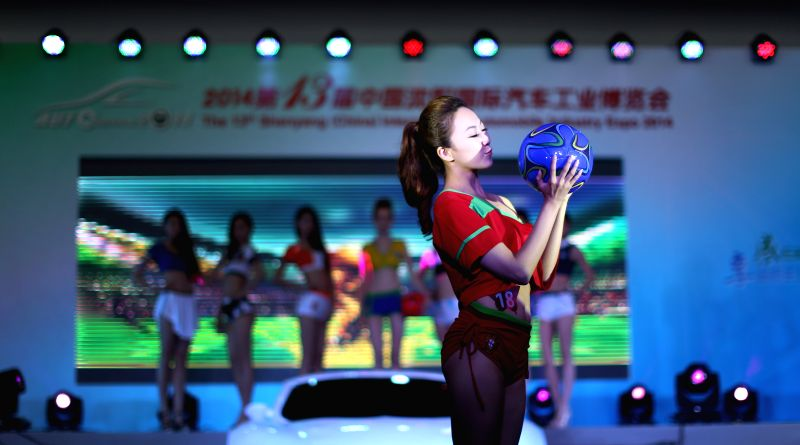 A contestant competes in the final of the northwest division of the China International Auto Super Model Contest in Shenyang, northwest China's Liaoning Province, .