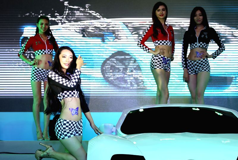 Contestants compete in the final of the northwest division of the China International Auto Super Model Contest in Shenyang, northwest China's Liaoning Province, ...