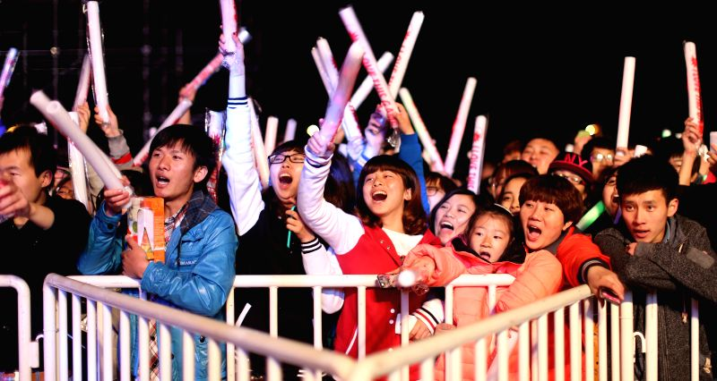 "Audience watch shows of the Polish band ""Scream Maker"" at Shenyang Ligong University in Shenyang, capital of northeast China's Liaoning Province, May 7, ..."