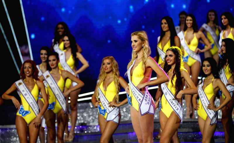 Shenzhen (China): Models perform during the contest in Shenzhen, China, on Nov. 29, 2014. U.S. model Shelynne Hoyt was crowned at the 26th Miss Model of the World International Grand Final Contest in - Shelynne Hoyt