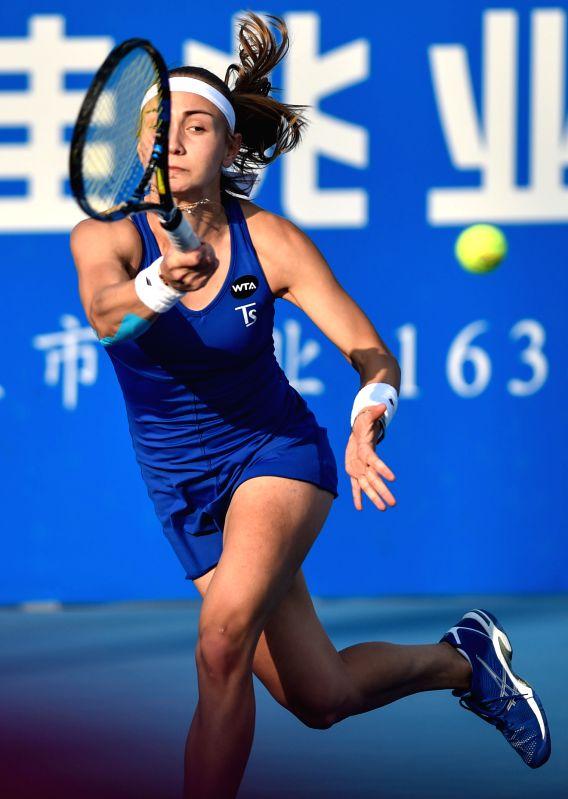 Aleksandra Krunic of Serbia returns the ball during the quarterfinal of singles against Simona Halep of Romania of 2015 WTA Shenzhen Open Tennis Tournament at ...