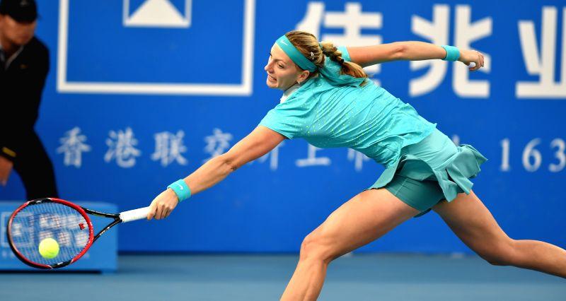 Petra Kvitova of Czech Republic returns the ball during the quarterfinal of singles against her compatriot Tereza Smitkova of 2015 WTA Shenzhen Open Tennis ...