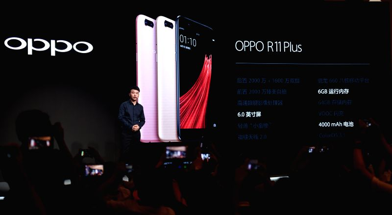 SHENZHEN, June 9, 2017 - OPPO smartphone R11 is newly released at a press conference in Shenzhen, south China's Guangdong Province, June 9, 2017. The new smartphone is featured with 20-mega-pixel ...