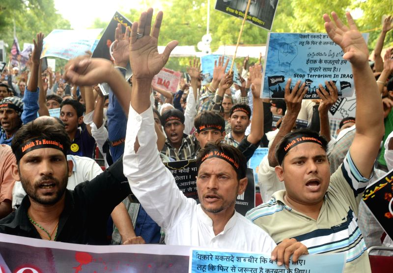 Shia Muslims demonstrate against violence in Iraq at Jantar Mantar in New Delhi on June 29, 2014.
