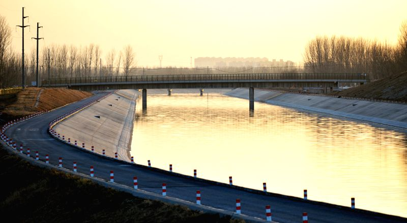 Photo taken on Dec. 12, 2014 shows the main canal of the south-to-north water diversion project in Baoding, north China's Hebei Province. The middle route of ..