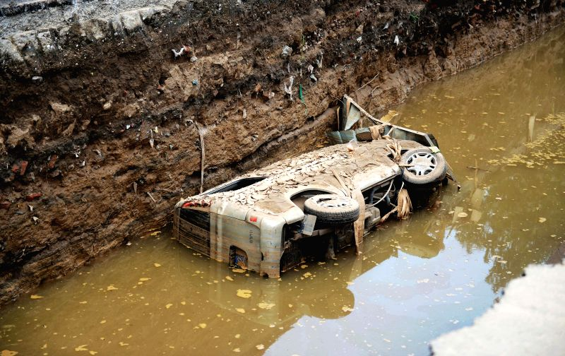 SHIJIAZHUANG, July 24, 2016 - A vehicle destroyed in floods is seen in Daxian Village of Xingtai City, north China's Hebei Province, July 24, 2016. Torrential rain and floods have left 130 people ...