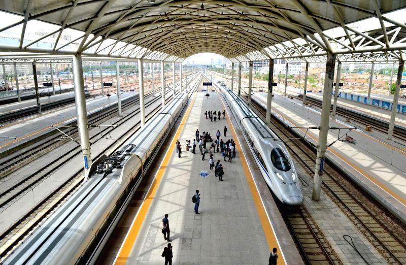 SHIJIAZHUANG, May 15, 2016 - A bullet train arrives at Shijiazhuang Railway Station in Shijiazhuang, capital of north China's Hebei Province, May 15, 2016. China will run more trains from Sunday, the ...