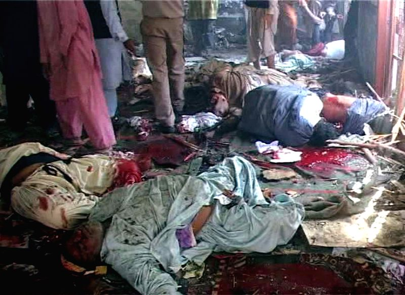 Bodies of victims are seen inside a mosque at the blast site in southern Pakistan's Shikarpur on Jan. 30, 2015. At least 35 people were killed and over 50 others .