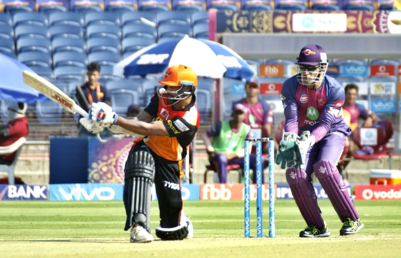 Shikhar Dhawan of Sunrisers Hyderabad in action during an IPL 2017 match between Rising Pune Supergiant and Sunrisers Hyderabad at Maharashtra Cricket Association Stadium in Pune on April 22, ... - Shikhar Dhawan and MS Dhoni