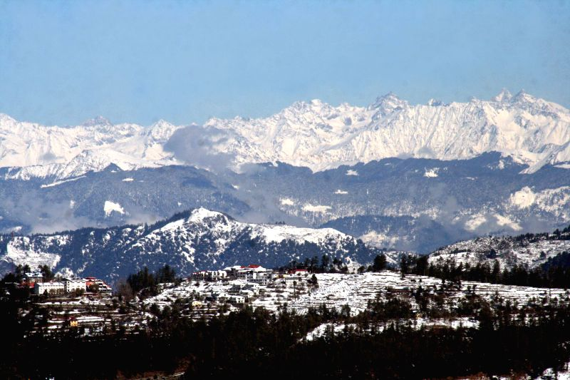 A view of snow-clad mountains after heavy snowfall in Shimla, on Dec 16, 2014.