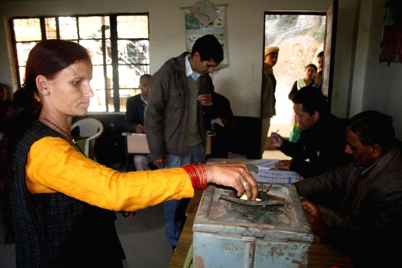 A woman casts her vote during Himachal Pradesh Panchayat Polls in Kuftadhar, Shimla on Nov 30, 2014.