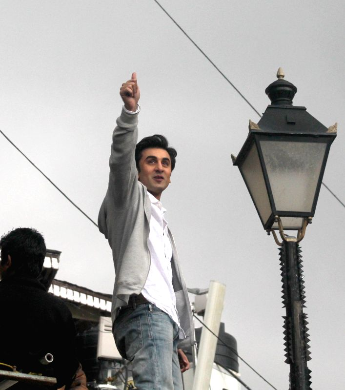 Actor Ranbir Kapoor waves to his fans during shooting of his upcoming film `Tamasha` in Shimla, on March 30, 2015.