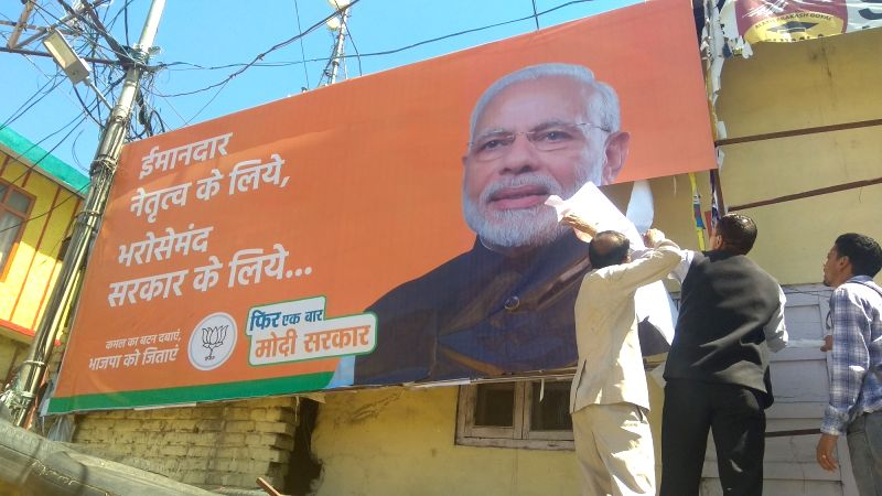 Shimla: An election campaign banner of BJP being removed ahead of the 2019 Lok Sabha elections, in Shimla on May 4, 2019. (Photo: IANS)
