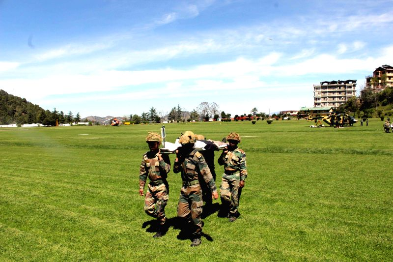 Army personnel participate in 'Mountain Rescue' - a mock drill at Annandale ground in Shimla on April 10, 2015.
