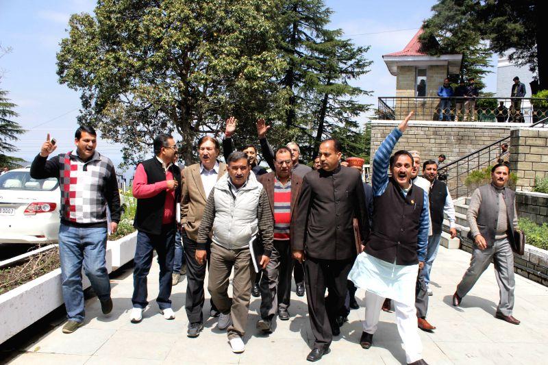 BJP MLAs walk out of Himachal Pradesh Legislative Assembly in Shimla on April 2, 2015.