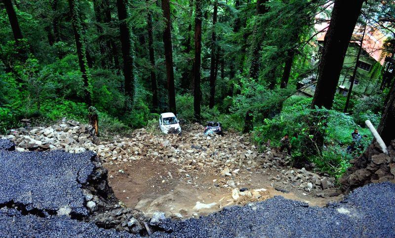 Shimla : Car damaged due to landslide after heavy rains, in Shimla, on July 19, 2018.