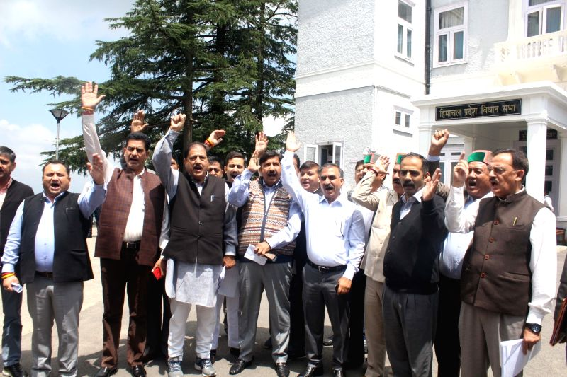 Shimla: Congress MLAs led by Leader of opposition Mukesh Agnihotri stage a walkout of the Himachal Pradesh Assembly over former Union Finance Minister P. Chidambaram's arrest by the Central Bureau of Investigation (CBI), on Aug 22, 2019. (Photo: IANS