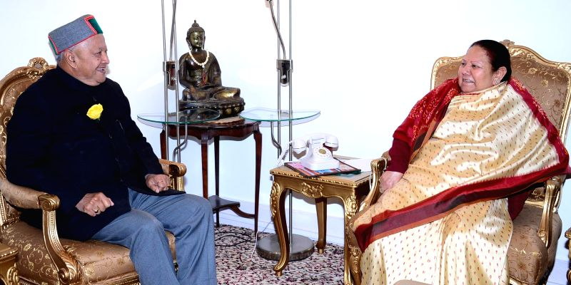 Himachal Chief Minister Virbharda Singh calls on the Governor of the state Urmila Singh at Raj Bhavan to greet her on new year in Shimla on Jan 1, 2015. - Virbharda Singh