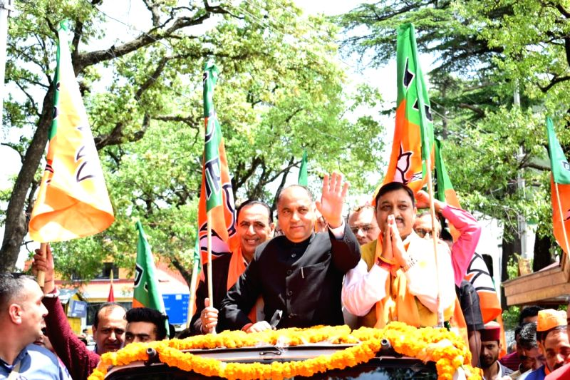 Shimla: Himachal Pradesh Chief Minister Jai Ram Thakur and BJP's Lok Sabha candidate from Shimla, Suresh Kashyap during a roadshow ahead of the latter's filing of nomination for the forthcoming Lok Sabha elections, in Shimla on April 25, 2019. (Photo