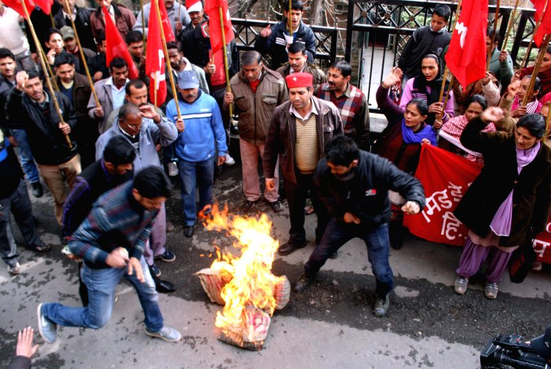 Mid Day Meal workers burn effigy of Prime Minister Narendra Modi in the recent Budget, presented by the central government in Shimla, on March 15, 2015. - Narendra Modi