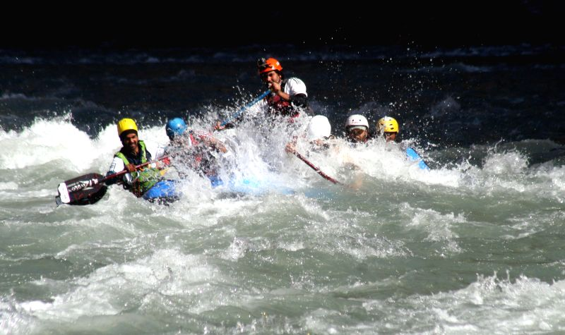 Rafters participate in the 11th National River Rafting Championship on Satluj river at Pandau, 85 km away from Shimla on Jan 9, 2015.