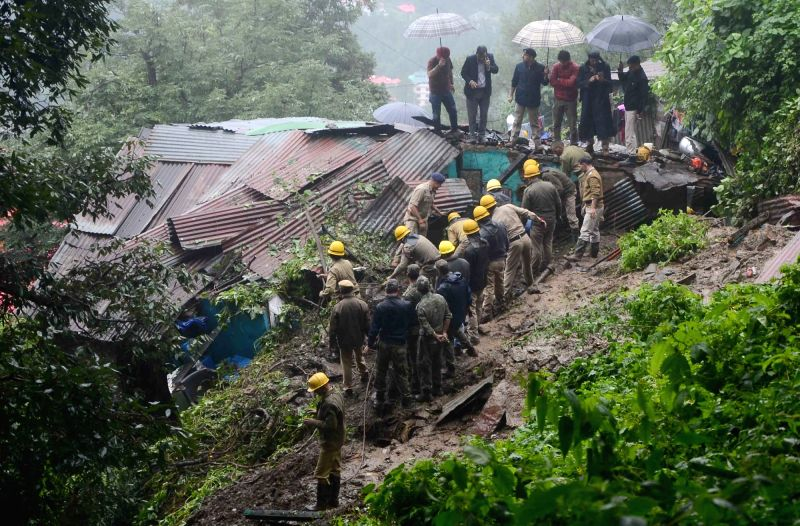 Shimla: Rescue operation underway after a massive landslide hit a house due to heavy rains near RTO office in Shimla on Aug 18, 2019. (Photo: IANS)