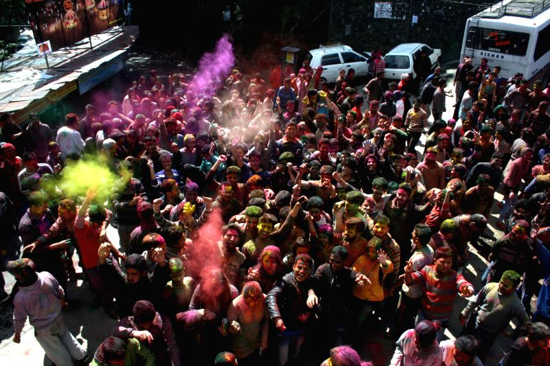 Students celebrate Holi at Himachal Pradesh University campus  in Shimla on March 6, 2015.