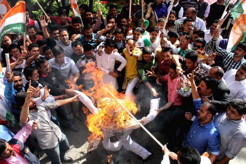 The Youth Congress activists burn effigies of BJP MP Anurag Thakur in Shimla, on April 27, 2015.