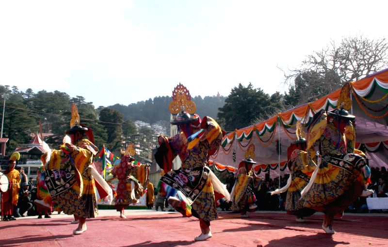 Tibetan artists perform during a programme organised to celebrate Republic Day at the Ridge in Shimla on Jan 26, 2015.